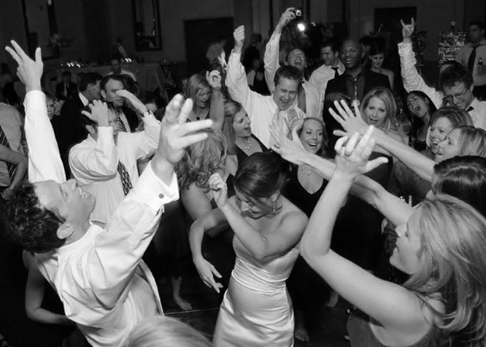 Crowd dancing at wedding